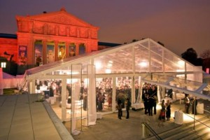North lawn tented event with the historic museum facade as a backdrop.